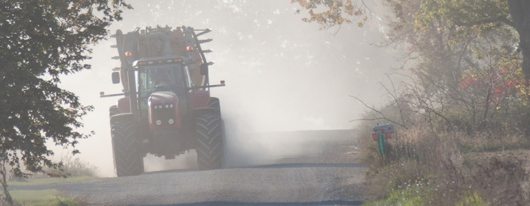 Dust from CAFO waste hauler creating hazardous conditions