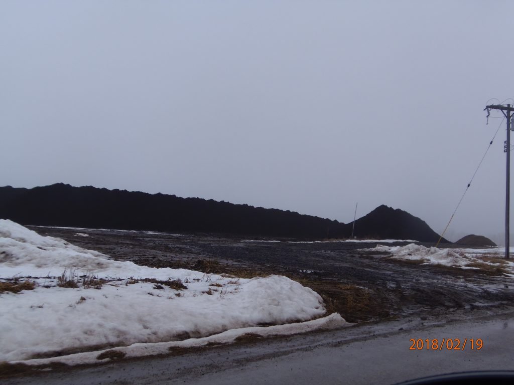 Feb. 19, 2018 – Halliwill/New Flevo/Van Brunt manure and compost stockpile on Forrister Rd. Melting snow and no containment cause manure to run off into the road and roadside ditch, carrying manure-laden water to the South Branch of the Raisin. This is a frequent problem at this site.